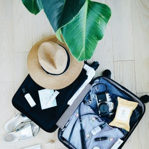 Travel Gear- open suitcase with hat