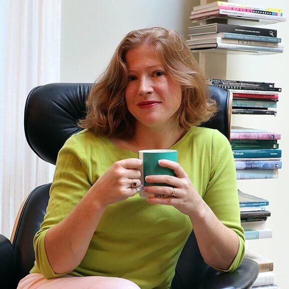 Cynthia Portrait sitting with coffee mug